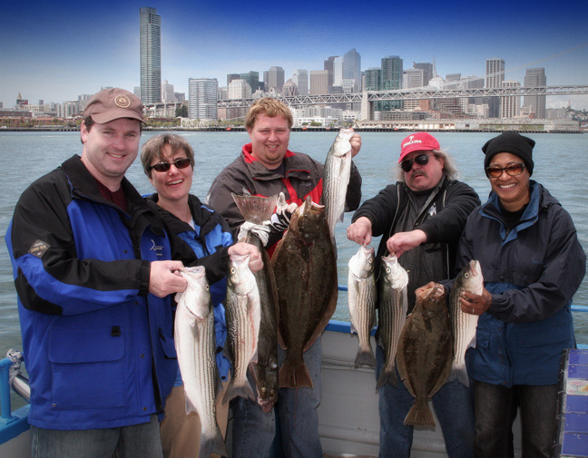 Fishing charter group with their catch in front of San Francisco landscape
